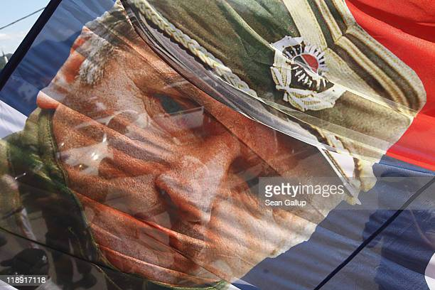 A supporter of the Serbian Radical Party waves a flag that depicts Ratko Mladic former Chief of Staff of the Bosnian Serb army and currently on trial...