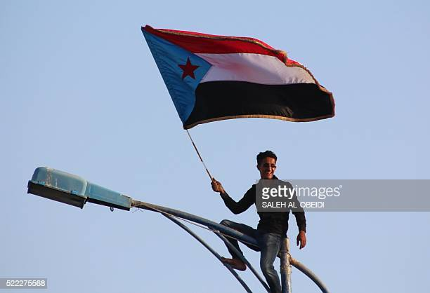 A supporter of the southern separatist movement waves the movement's flag during a rally calling for independece of the south in Yemen's second city...
