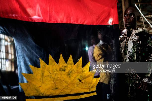 A supporter of the the Indigenous People of Biafra displays the Biafra flag on May 28 2017 during a service at the St Martin Tour Catholic Church in...