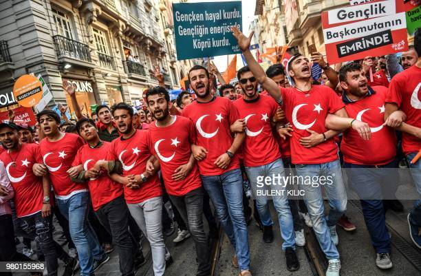 TOPSHOT Supporter of the Turkish president wear Tshirts in the design of the national flag during an election campaign rally of Justice and...