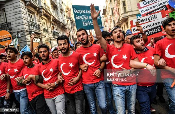 Supporter of the Turkish president wear Tshirts in the design of the national flag during an election campaign rally of Justice and Development Party...