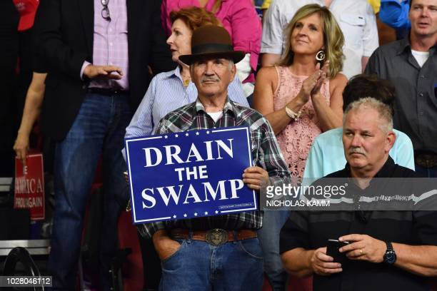 A supporter of the US president holds up a sign reading drain the swamp during a Make America Great Again rally in Billings Montana on September 6...