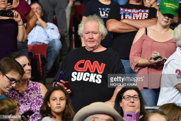 A supporter of the US president wears a tshirt reading CNN sucks during a Make America Great Again rally in Billings Montana on September 6 2018