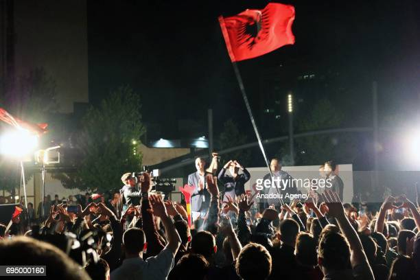 Supporter of the Vetevendosje party waves an Albanian national flag as they celebrate their success according to informal results of 90 percent of...