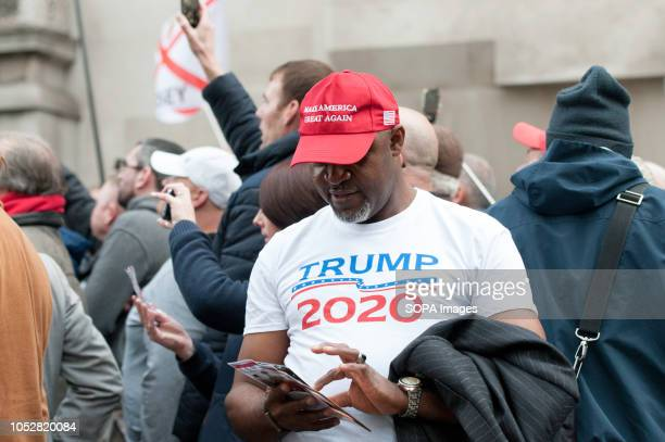 Supporter of Tommy Robinson seen wearing a hat and tshirt alluding to United States President Donald Trump The rightwing leader whose real name is...