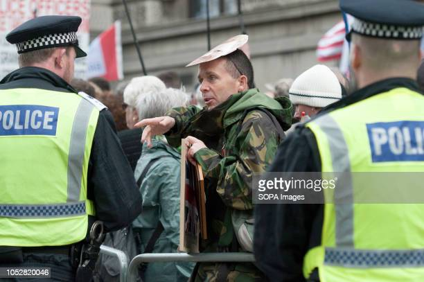 Supporter of Tommy Robinson talking with a police officer The rightwing leader whose real name is Stephen YaxleyLennon was released in August on...