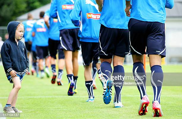 A supporter of TSG 1899 Hoffenheim watches the team warming up during a training session at the DietmarHopp Stadion on June 22 2011 in Hoffenheim...