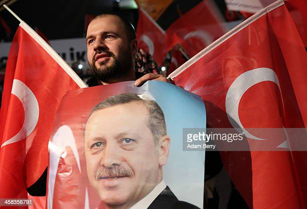 A supporter of Turkish Prime Minister Recep Tayyip Erdogan attends a rally at Tempodrom hall on February 4 2014 in Berlin Germany Turkey will soon...