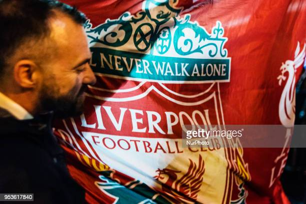 A Supporter of United Kingdom's Liverpool team dances with the team's flag out of a pub in Campo de' Fiori Square in Rome Italy the night before UEFA...