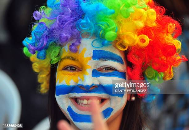 A supporter of Uruguay's presidential candidate for the opposition Partido Nacional party Luis Lacalle Pou with the face painted in the Uruguayan...