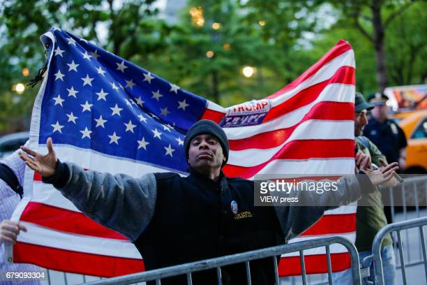 A supporter of US president Donald Trump argues with Activists as they take part in a protest near the USS Intrepid where US president Trump is...