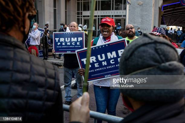 A supporter of US president Donald Trump argues with people protesting in support of counting all votes as the presidential election in Pennsylvania...