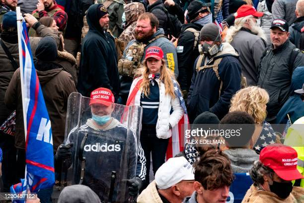 Supporter of US President Donald Trump carries a US Capitol Police riot shield during a protest outside the US Capitol on January 6 in Washington,...