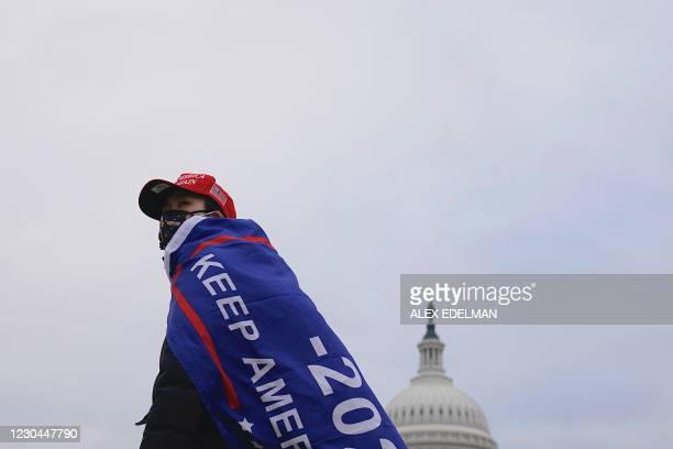 Supporter of US President Donald Trump challenging the results of the 2020 US Presidential election arrives outside the US Capitol on January 6, 2021...