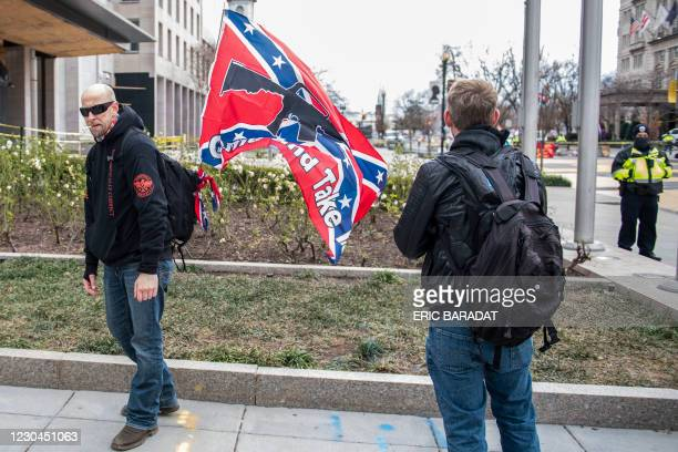 Supporter of US President Donald Trump display a Confederate flag next to Black Lives Matter Plaza as supporters from around the country rally in the...