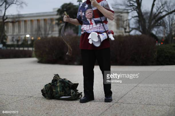 A supporter of US President Donald Trump holds a shofar while speaking into a bullhorn outside the US Capitol ahead of a joint session of Congress in...