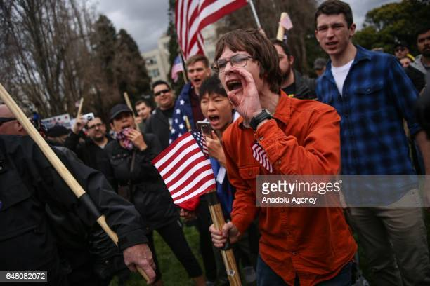 A supporter of US President Donald Trump shouts at antiTrump protestors after violence broke out during a free speech rally in Berkeley United States...