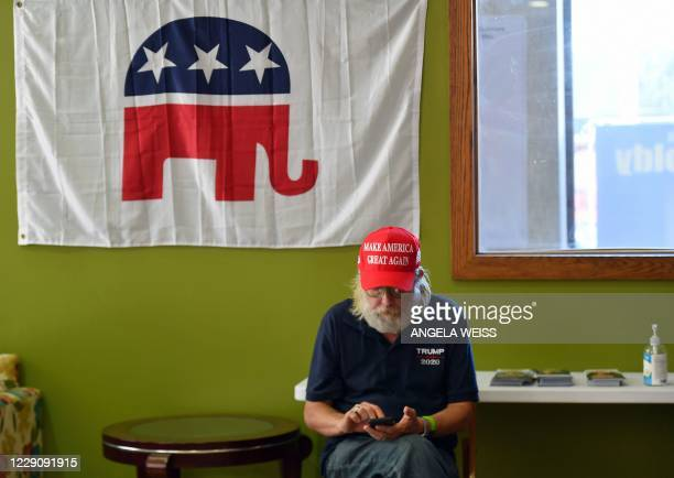Supporter of US President Donald Trump sits at the Republican Party of Lackawanna County headquarters and MAGA victory office on September 30, 2020...
