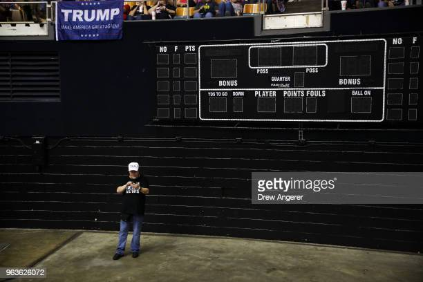 A supporter of US President Donald Trump waits for the start of a rally at the Nashville Municipal Auditorium May 29 2018 in Nashville Tennessee...