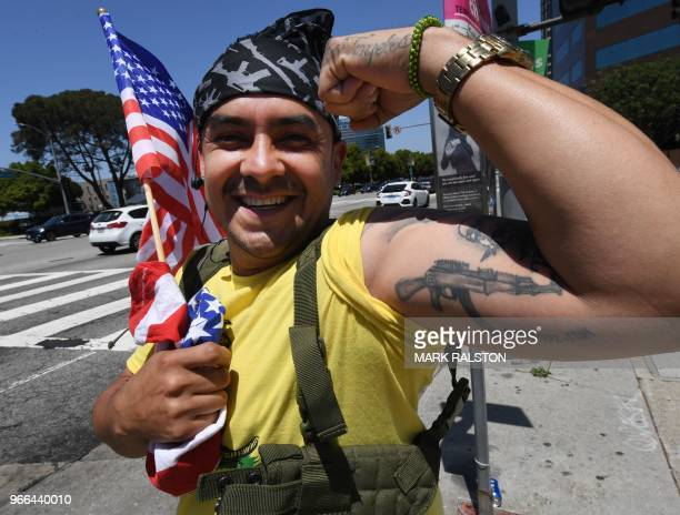 A supporter of US President Trump shows his gun tattoo as they hold a 'Make California Great Again' rally to support Los Angeles County's Republican...