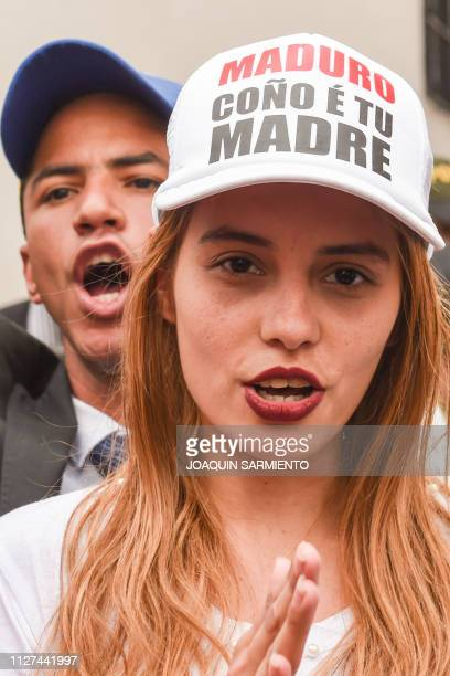 A supporter of Venezuelan opposition leader and selfdeclared acting president Juan Guaido wears a cap against Venezuela's President Nicolas Maduro as...