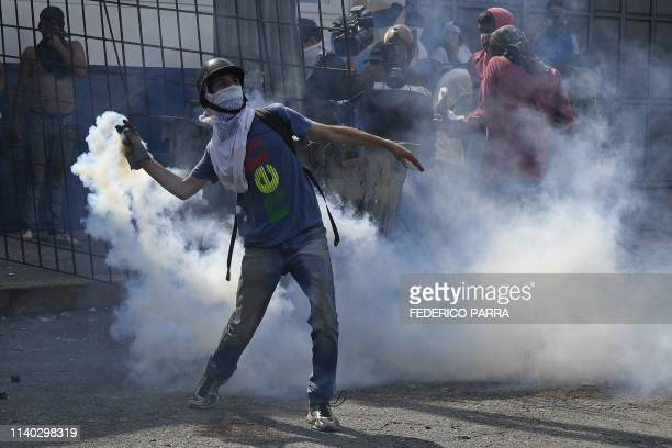 A supporter of Venezuelan opposition leader and selfproclaimed acting president Juan Guaido clashes with forces loyal to President Nicolas Maduro...