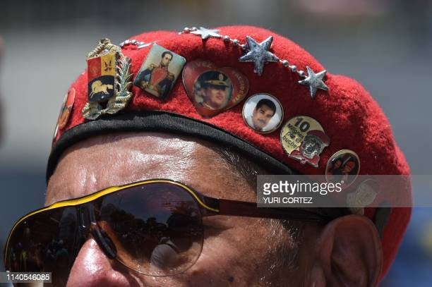 A supporter of Venezuelan President Nicolas Maduro attends a May Day rally in Caracas on May 1 2019 Pro and antigovernment rallies were due to take...
