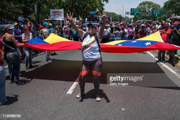 Supporter of Venezuelan President Nicolás Maduro gestures during a demonstration on May 1 2019 in Caracas Venezuela Yesterday Venezuelan opposition...