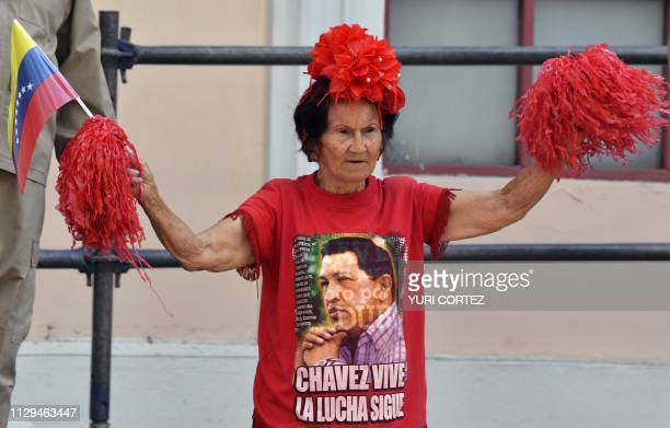 A supporter of Venezuela's President Nicolas Maduro waves a flag during a rally at the Miraflores Presidential Palace in Caracas Venezuela on March 9...