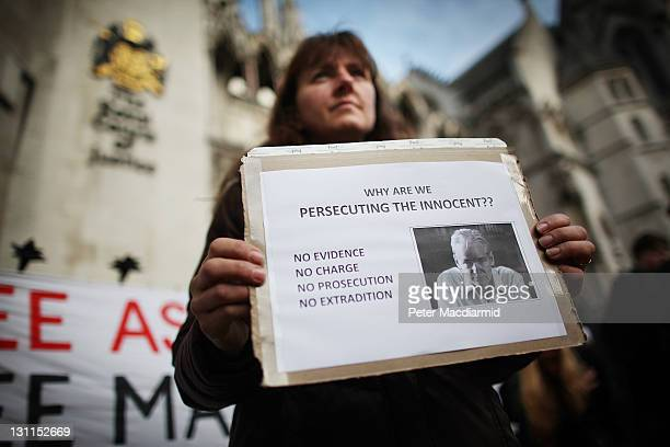 A supporter of WikiLeaks founder Julian Assange holds a placard outside The High Court on November 2 2011 in London England Mr Assange is appearing...