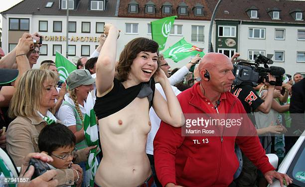A supporter of Wolfsburg celebrates the German championship after the Bundesliga match against SV Werder Bremen on May 23 2009 in Wolfsburg Germany...