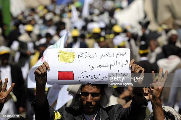 Supporter of Yemen's Shiite Houthi group holds banner during the anti government protest in Sanaa Yemen on September 7 2014 Yemen's Houthi protesters...