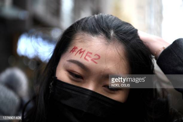 Supporter of Zhou Xiaoxuan, a feminist figure who rose to prominence during Chinas #MeToo movement two years ago, has a #MeToo penned on her forehead...
