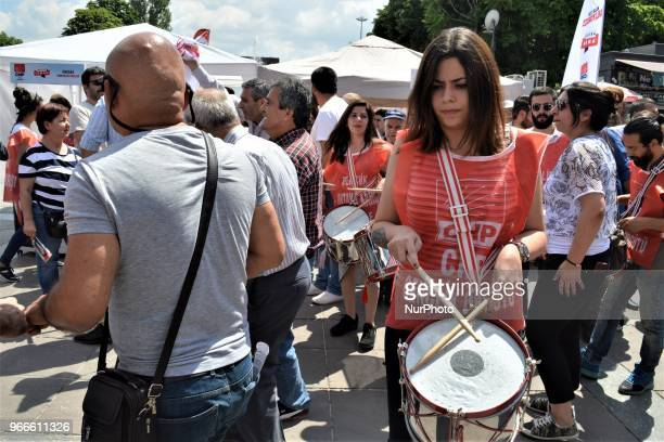 A supporter plays drums ahead of a march staged by the main opposition Republican People's Party for the early presidential and parliamentary...