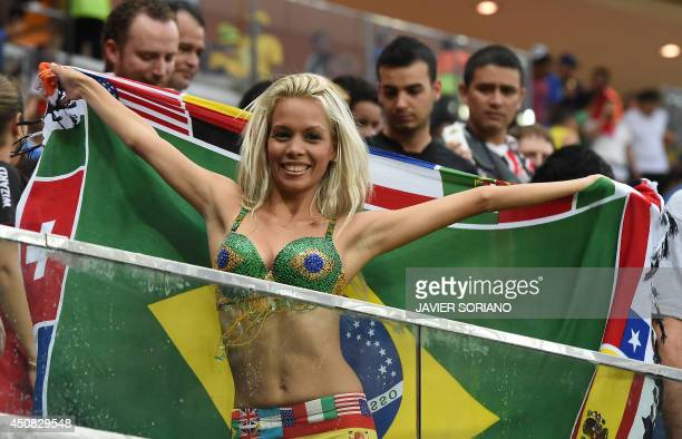 A supporter poses with the Brazilian flag ahead of the Group A football match between Cameroon and Croatia at The Amazonia Arena in Manaus on June 18...