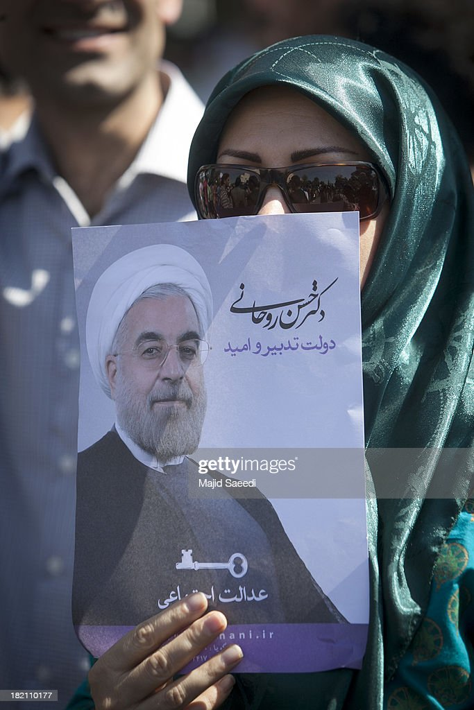 Supporter raise up posters depicting President Hassan Rouhani of Iran as his motorcade leaves Mehrabad Airport on September 28, 2013 in Tehran, Iran. Hardline Islamists gathered outside the airport to chant ''Death to America'' and ''Death to Israel'' but they were outnumbered by supporters of President Rouhani who shouted 'Thank you Rouhani.' Iranian newspapers hailed the first contact between presidents Rouhani and Obama but warned that Israel would seek to impede the historic opening to Washington.
