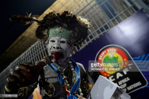 Supporter reacts after the 2019 Africa Cup of Nations Group A football match between Zimbabwe and DR Congo at the 30 June Stadium in the Egyptian...