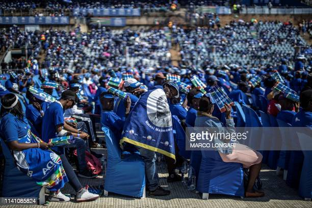 Supporter reacts as the South African opposition party Democratic Alliance leader delivers his speech during the final presidential election campaign...
