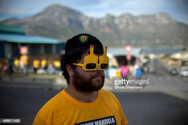 ANC supporter Roscoe Jacobs wears 3D glasses outside of the Hangberg Sports and Recreation Centre voting station in the Hangberg community in Hout...