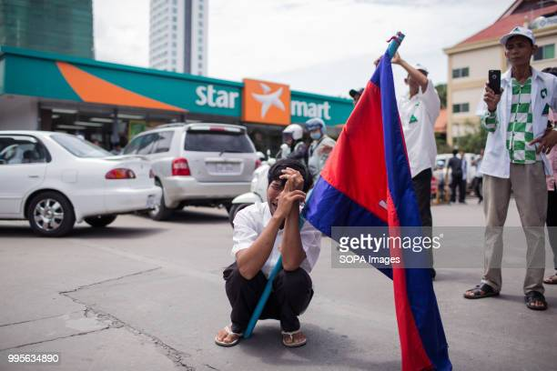 GDP supporter seen crying as he remembers the assassination of political analyst Kem Ley Grassroots Democratic Party is running for the July 2018...