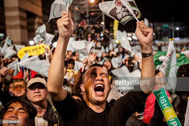 A supporter shouts as attend at DPP headquarters during Tsai Ingwen speach her election victory on January 16 2016 in Taipei Taiwan Tsai Ingwen the...