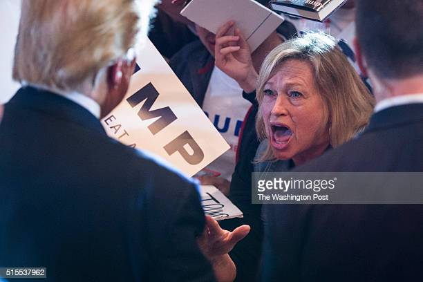 A supporter shouts to republican presidential candidate Donald Trump as he greets the crowd after speaking during a campaign event at the Savannah...