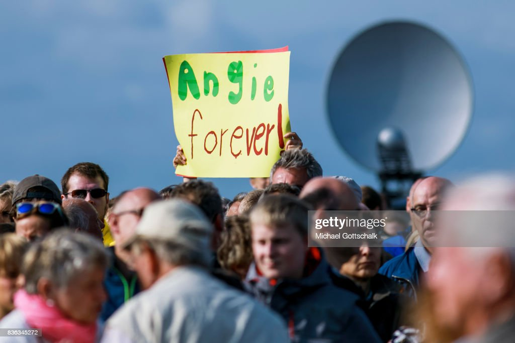 A supporter shows a sing reading Angie forever during Angela Merkels election campaign for Bundestagswahl 2017 or Federal election 2017 on August 21, 2017 in Sankt Peter-Ording, Germany.