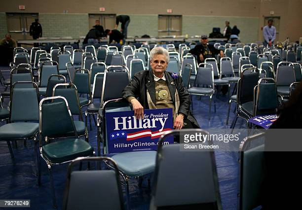A supporter sits alone after listening to Democratic presidential hopeful Sen Hillary Clinton during a post primary town hall meeting on the campus...