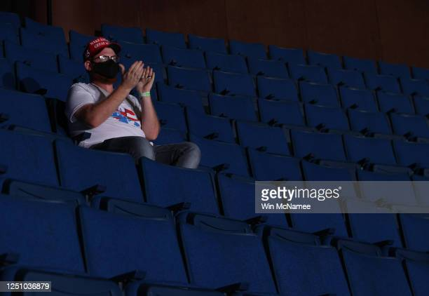 Supporter sits in the upper seats during a campaign rally for U.S. President Donald Trump at the BOK Center, June 20, 2020 in Tulsa, Oklahoma. Trump...