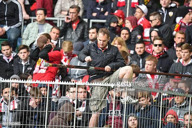 A supporter Stuttgart reacts after the Bundesliga match between VfL Wolfsburg and VfB Stuttgart at Volkswagen Arena on May 14 2016 in Wolfsburg...