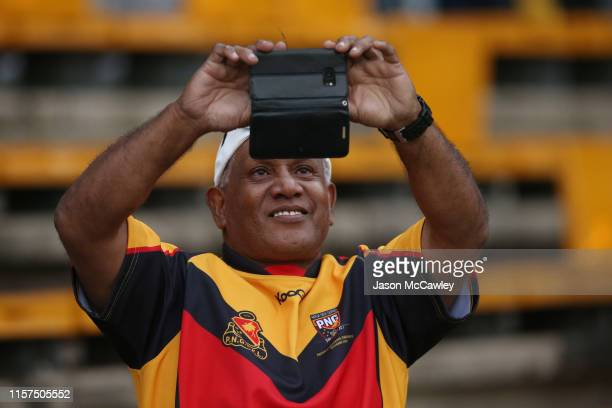 Supporter takes a photo during the Women's Pacific International Test Match between Fijji and Papua New Guinea at Leichhardt Oval on June 22, 2019 in...