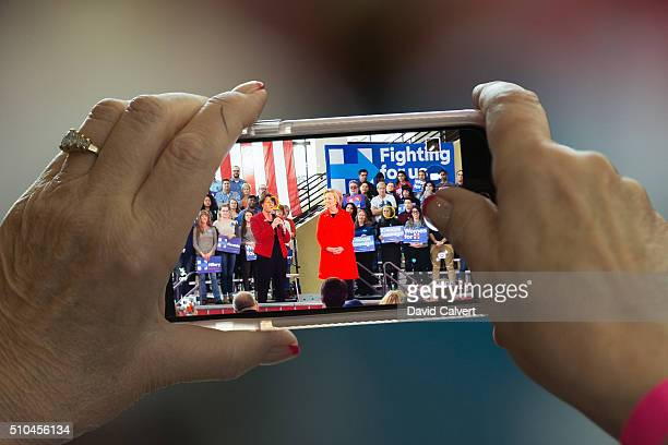 A supporter takes a photo of Democratic Presidential candidate and former Secretary of State Hillary Clinton speaks at a campaign rally at Truckee...