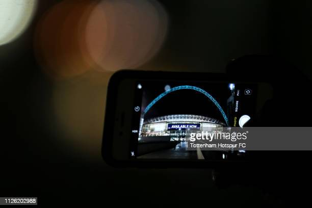 A supporter takes a photo of the stadium on their mobile phone ahead of the Premier League match between Tottenham Hotspur and Watford FC at Wembley...