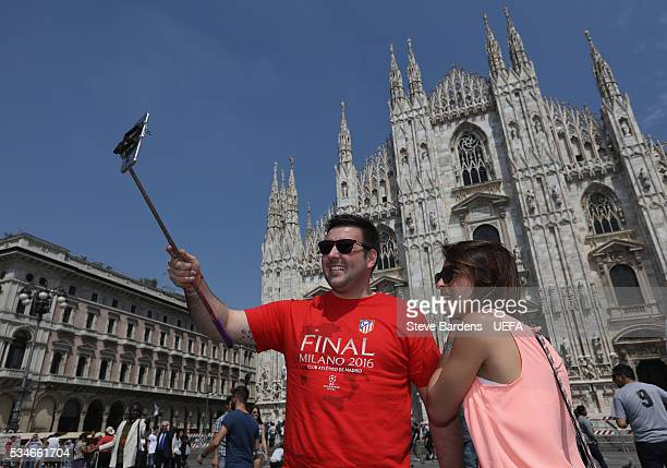 A supporter takes a selfie during the Fans Festival outside the Duomo in the centre of Milan prior to the UEFA Champions League Final between Real...